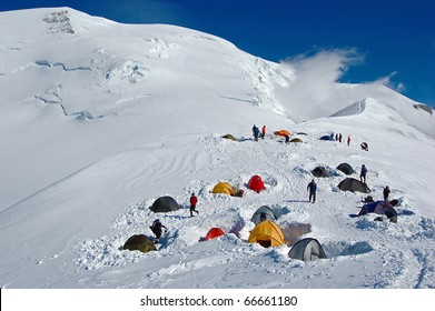 Colorful tents in high snowy mountains, (Refuge du Goater) halfway up Mont Blanc in France