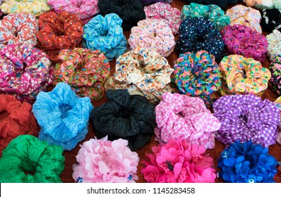 Colorful textile scrunchies. Elastic bobble hair bands. Modern style multi-color mix pattern. Colorful mix for background