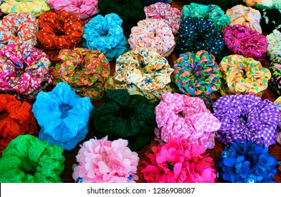 Colorful textile scrunchies. Elastic bobble hair bands. Colorful mix for background