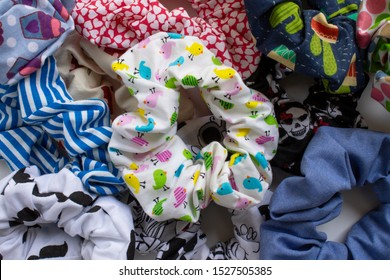 Colorful textile scrunchies. Hair elastic used as a fashion accessory.