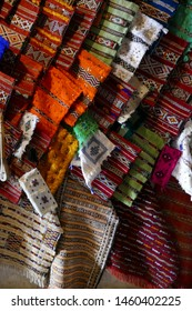 Colorful textiles line the narrow streets of the bazaar of medina of Fes, Morocco, Africa