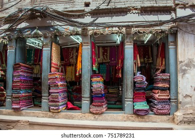 Colorful textiles, woven rugs and mats on display in open air market and store in Kathmandu, Nepal