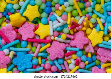 Colorful Texture Closeup of Sweet Yellow, Blue, Pink Sticks, Stars, Flowers. Topping for Sprinkles Cakes or Cupcakes.