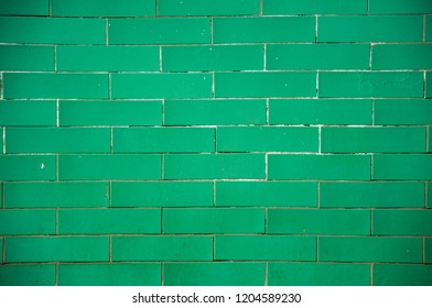 Colorful textured chewing gum background. Green mint color brick