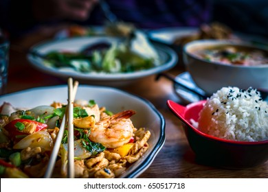 Colorful Thai food in a restaurant settings; various dishes on the table; colorful food, Asian food
