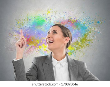 Colorful Thinking. Business woman against gray background and colorful splashes
