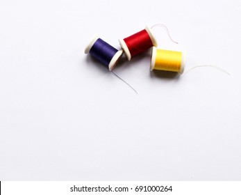 Colorful Thread on White Background