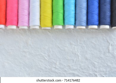 colorful thread on a white background