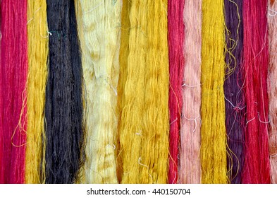 Colorful thread silks dye from natural color material for woven silk handicraft thai style at isan of Thailand