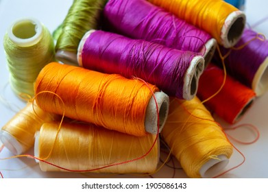 colorful threads that we can linger at home.fun with colorful strings.set of color threads on a white background