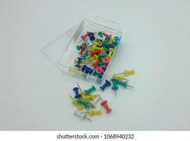 colorful thumbtacks with box