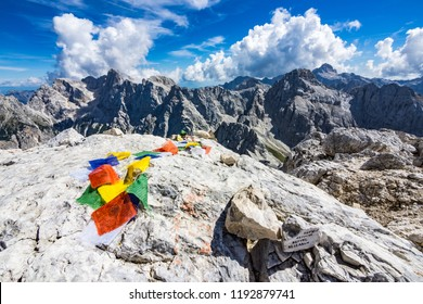 Colorful Tibetan praying flags on the top of the Prisank mountain in Julian alps, Slovenia