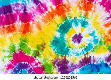 colorful tie dye pattern hand dyed on cotton fabric abstract background.