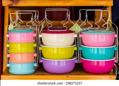Colorful of tiffin box on shelf for sale.