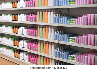 Colorful toiletries plastic bottles in retail store shelves