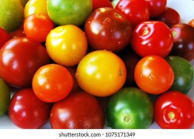 Colorful tomatoes. Green, yellow, orange and red tomatoes.
