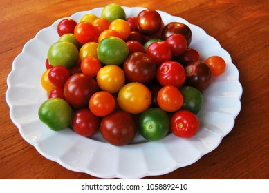 Colorful tomatoes on white plate