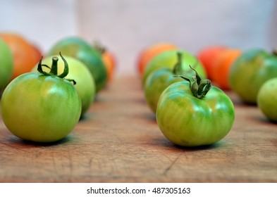 Colorful tomatoes on the wooden board