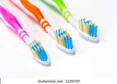colorful toothbrushes isolated on white background