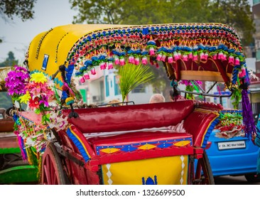 Colorful tourist rickshaw with tassles and flowers awaits the ne