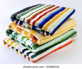 Colorful towels on white background.