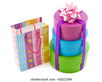 Colorful tower of gift boxes with funny bag isolated over white