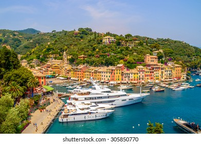Colorful town of Portofino, Italy and it's port with yachts, on a hot summer day