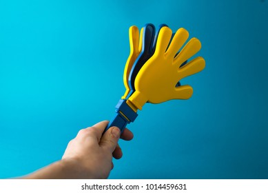 Colorful toy hand clap on white background