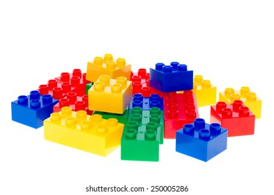 Colorful toy plastic building blocks isolated on white background