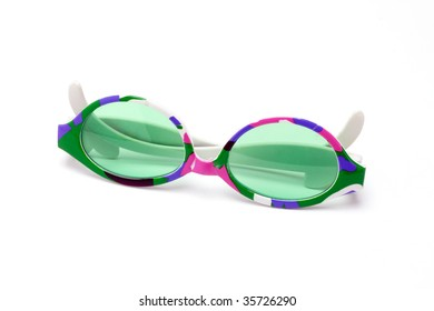 Colorful toy sunglasses on white background