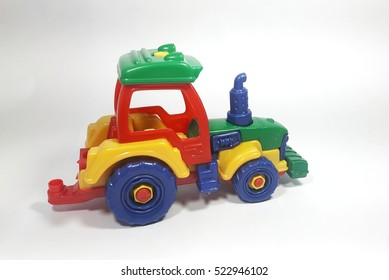 Colorful toy tractor on white isolated background