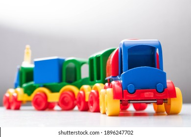 Colorful toy train on a white background. Kid's toys close up