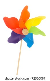Colorful toy wind mill isolated over white