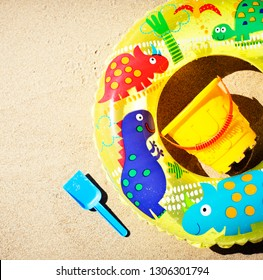 colorful toys for child sandboxes against the beach sand background/summer holidays background