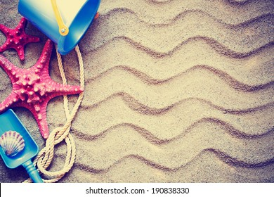 colorful toys for childrens sandboxes against the beach sand background/summer holidays background