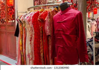 Colorful traditional chinese costumes hanging for sale during Chinese New Year.