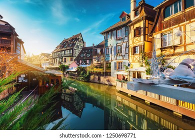 Colorful traditional half timbered houses on the bank of river with reflection at Cristmas days Petite Venice Colmar, France