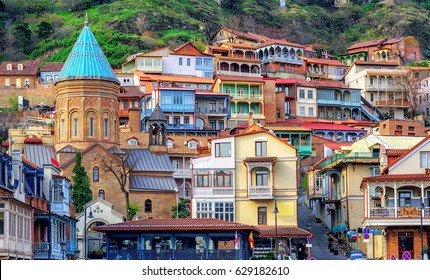 Colorful traditional houses with wooden carved balconies in the Old Town of Tbilisi, Georgia