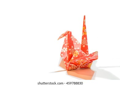 Colorful traditional Japanese origami crane in side view with space for text