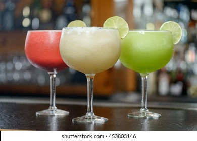 Colorful Traditional Mexican food and drink dishes margaritas and daiquiris