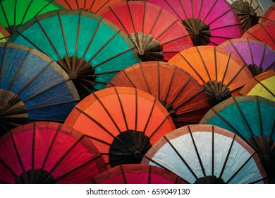 Colorful traditional paper umbrellas on the market. Laos, Luang Prabang