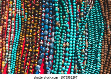 Colorful traditional  souvenir Necklaces are sold on the tourist market in Kathmandu, Nepal. Contain of ornaments and small figures.