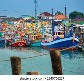 Colorful Traditional Thai Fishing Boats in the marina Thailand