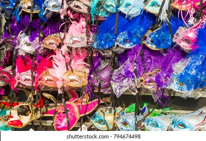 Colorful traditional venetian carnival masks on sale in store