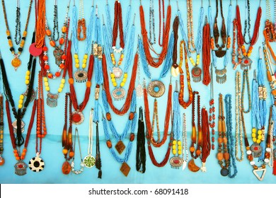 colorful traditional vintage necklace on blue background