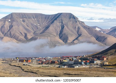 Colorful traditional wooden houses on a cloudy day. Longyearbyen town, Svalbard.