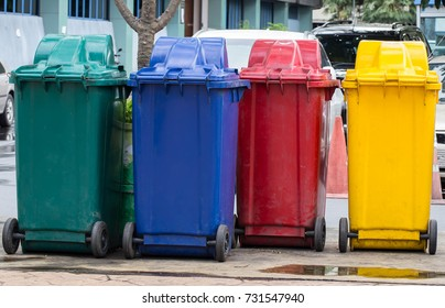 Colorful trash bins are used for separate type of junk, garbage and trash