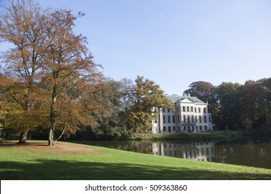 colorful trees and pond in the park of manor broekhuizen near leersum in the province of utrecht in the netherlands during fall