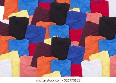 Colorful T-shirts folded background