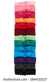 colorful T-shirts rolled group on background